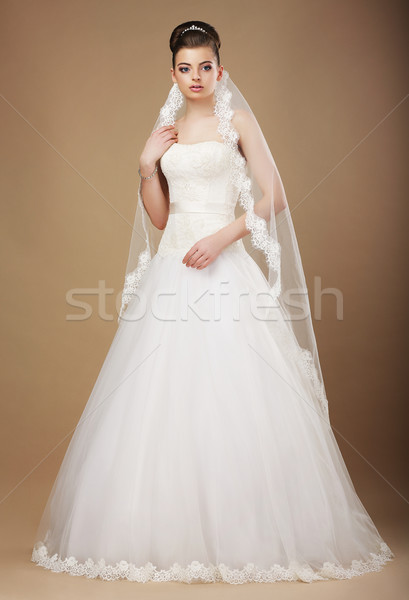 Wedding. Beautiful Graceful Bride in White Long Dress and Viel Stock photo © gromovataya