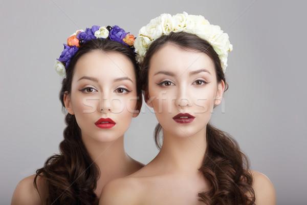 Elegance. Two Women with Wreaths of Flowers. Fantasy Stock photo © gromovataya