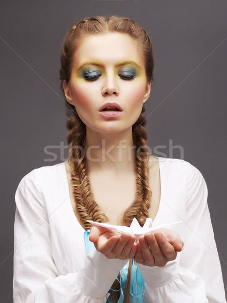 Aspiration. Caucasian Woman in White Dress releasing Origami Pigeon. Kindness Stock photo © gromovataya