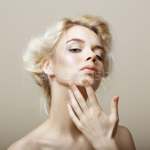 Stock photo: Sentimentality. Natural Blonde Woman touching her Clean Face. Pampering