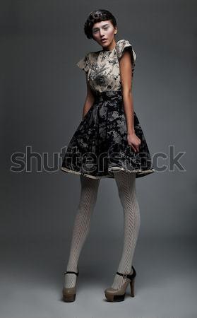 Kentsel moda olağandışı kadın kısa siyah elbise Stok fotoğraf © gromovataya