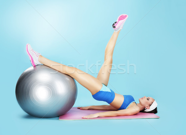 Aerobics. Sportswoman in Sport Club with Fitness Ball Stock photo © gromovataya