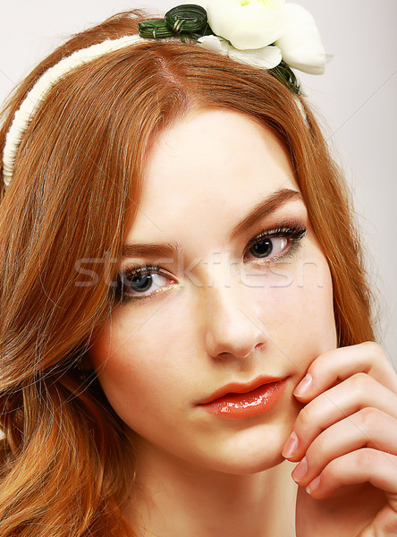 Goodness. Portrait of Young Meek Woman with White Flower on her Head Stock photo © gromovataya