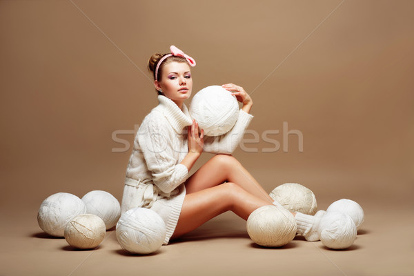 Knitting. Sewing. Woman in White Knitted Clothing with Bulk of Fluffy Clews of Yarn Stock photo © gromovataya