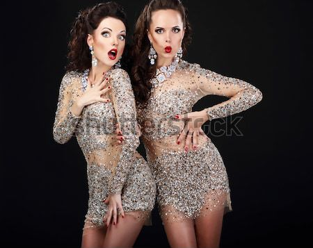 Luxury. Two Sexy Glamorous Women in Shiny Dresses Stock photo © gromovataya