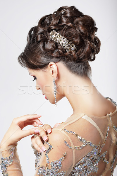 Stock photo: Elegance and Chic. Beautiful Brunette with Classy Hairstyle. Luxury