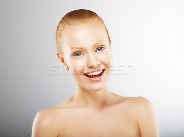 Carefree Young Woman Having Fun and Smiling. Pleasure Stock photo © gromovataya