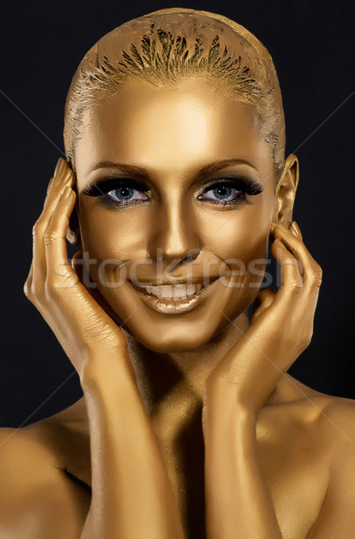 Un coup d'œil femme souriante fantastique or maquillage Photo stock © gromovataya