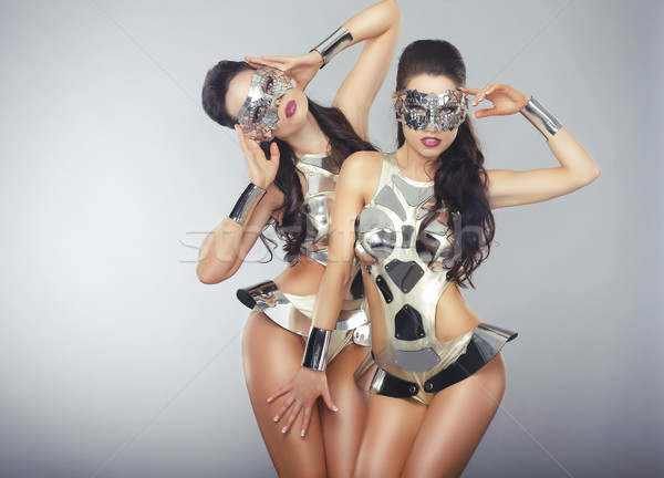 Vogue. People in Sparkling Cosmic Cyber Costumes Gesturing Stock photo © gromovataya