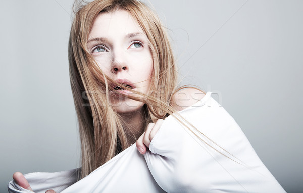 Stock photo: Nightmare - frightened lovely woman blonde in white clothes