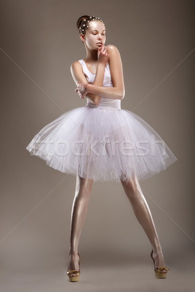 Sensuality. Elegant Styled Woman posing in White Dress. Fantasy Stock photo © gromovataya