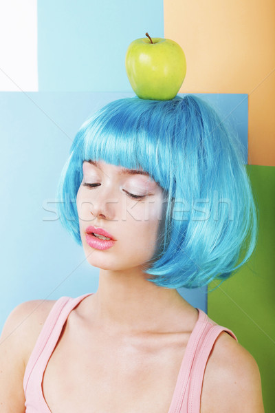 Bizarre Stylized Woman in Blue Wig with Green Apple Stock photo © gromovataya
