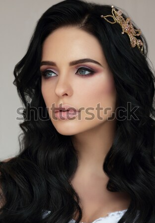 Image of Young Brunette with Golden Tears on her Face Stock photo © gromovataya