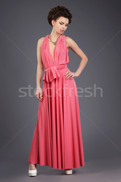 Elegance. Stylish Brunette in Pink Festive Dress Stock photo © gromovataya