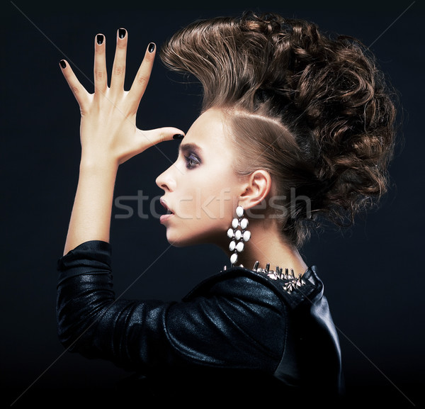 Beauty woman with pigtails, creative hairstyle, saluting Stock photo © gromovataya
