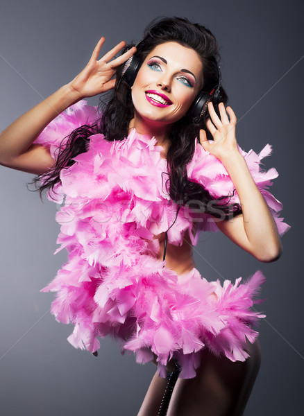 Fashion young sexy girl with headphones dancing. Happy smile Stock photo © gromovataya