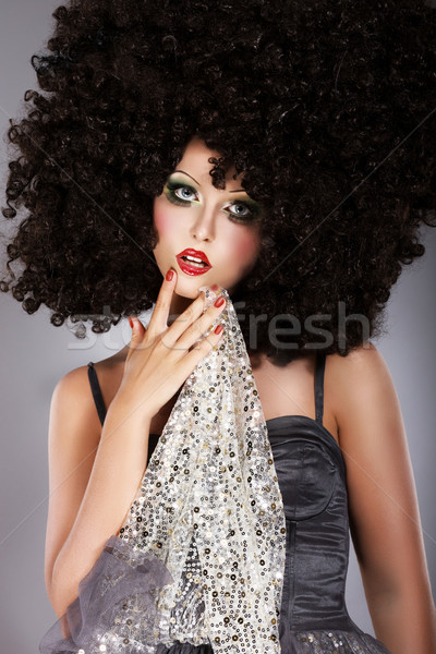 Futurism. Fanciful Girl in Huge Unusual Black African Frizzy Wig Stock photo © gromovataya
