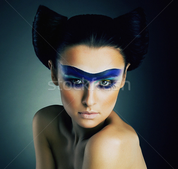 Haute Couture. Fantasy. Classy Woman with Blue Painted Mask and Modern Hairstyle Stock photo © gromovataya