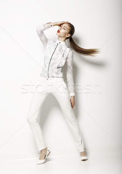 Contemporary Clothing Design. Modish Woman in White Blouse and Pants. Fashion Stock photo © gromovataya