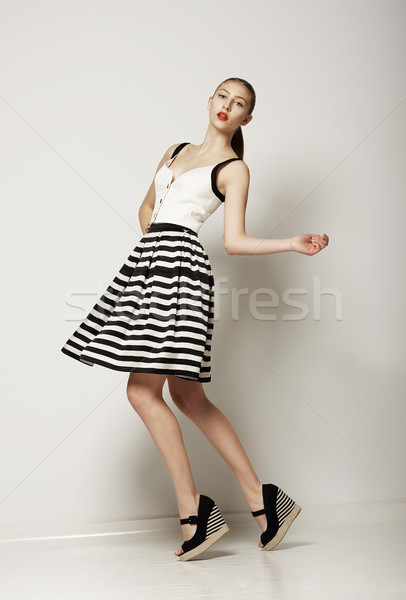 Fashion Style. Happy Young Shopper in Contrast Striped Grey Skirt. Movement Stock photo © gromovataya