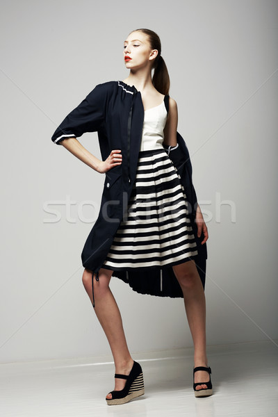 Ambitions. Confident Honorable Brunette in Black Waterproof Mackintosh. Vogue Style Stock photo © gromovataya