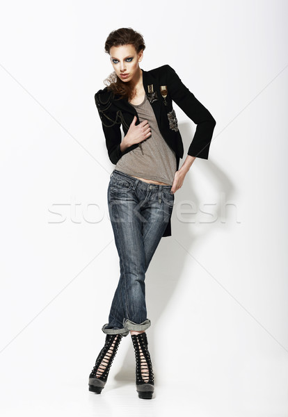 Vogue. Full Length Portrait of Stylish Woman in Informal Pose Stock photo © gromovataya