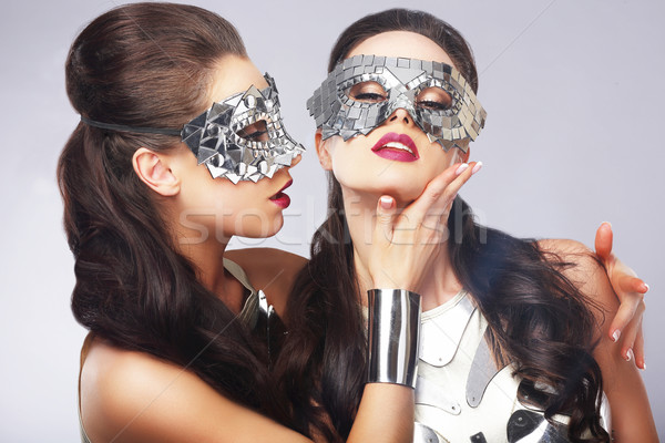Performance. Entertainment. Women in Silver Shiny Masks. Artistry Stock photo © gromovataya