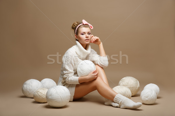 Housework. Young Woman in White Tricot with Woolen Balls. Seamstress Stock photo © gromovataya