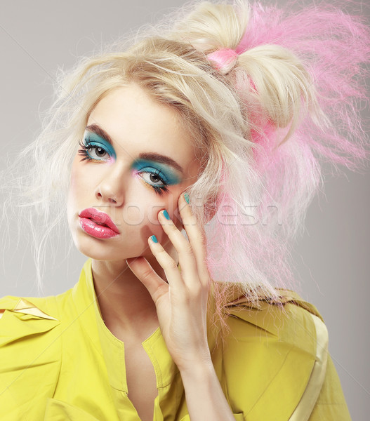 Portrait of Bright Blonde with Shaggy Hair and Blue Eye Makeup. Glam Stock photo © gromovataya