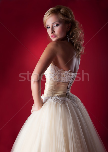 Bride fashion model in white bridal dress posing in studio Stock photo © gromovataya