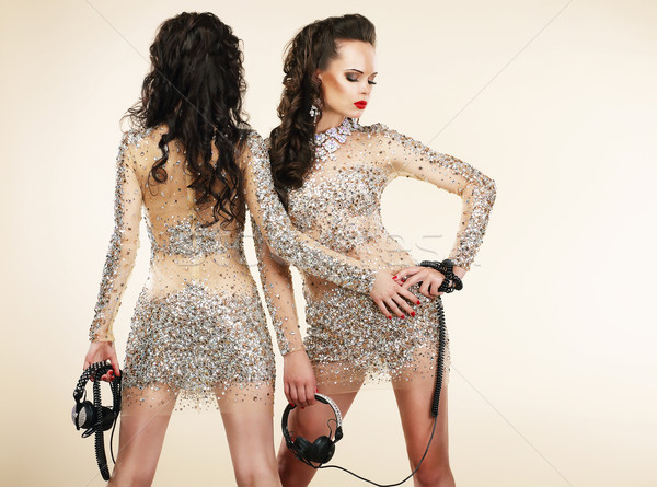 Fete. Clubbing. Two Women in Shiny Silver Dresses with Rhinestones Stock photo © gromovataya