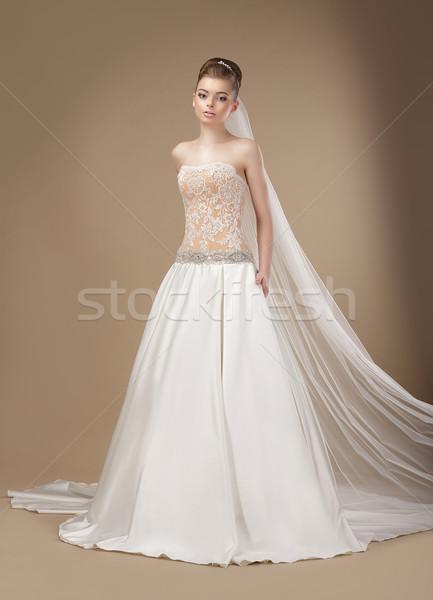 Luxury. Elegant Classy Brunette in Ivory Light Dress Stock photo © gromovataya