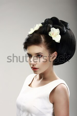 Vogue Style. Classy Charismatic Woman with Trendy Luxurious Hairstyle. Allure Stock photo © gromovataya