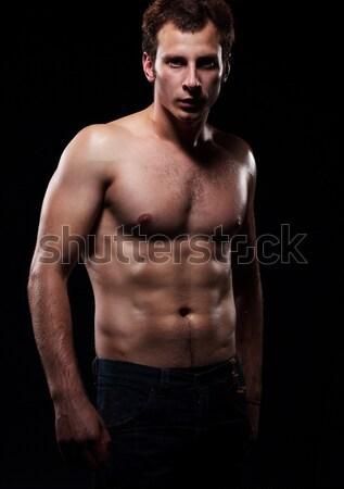 Corpo giovani muscolare uomo studio buio Foto d'archivio © gromovataya