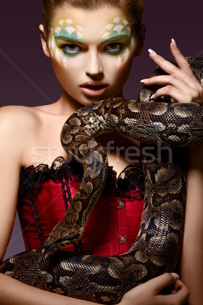 Serpent. Fantasy. Fancy Woman holding Tamed Snake in Hands Stock photo © gromovataya
