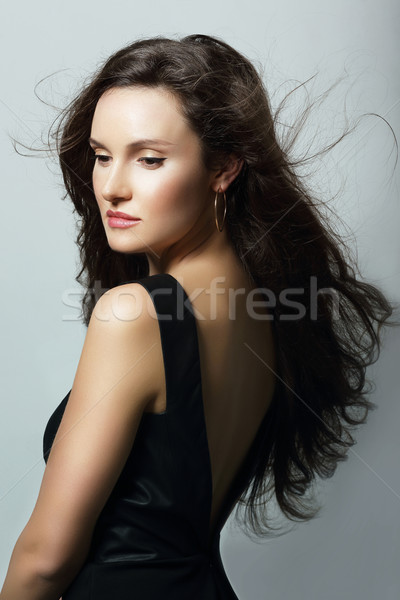 Charm. Aristocratic Lady in Black Dress and Flowing Hair Stock photo © gromovataya