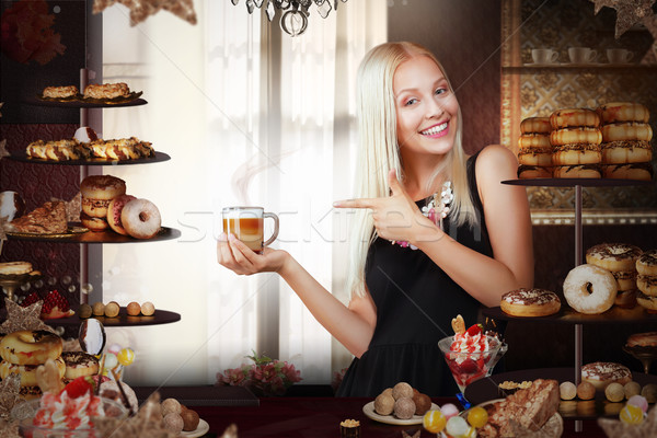 Bakery. Happy Saleswoman with Cup of Coffee in Bakeshop Stock photo © gromovataya