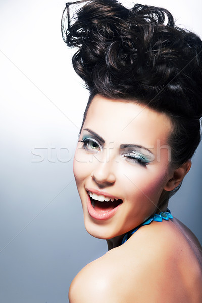Portrait of beautiful young laughing shopper woman Stock photo © gromovataya