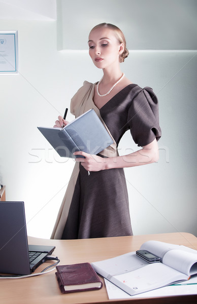 Elegant aristocratic lovely business woman studying Stock photo © gromovataya