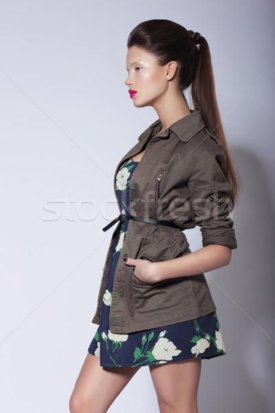 Stylishness. Fashionable Woman posing in Elegant Coat Stock photo © gromovataya