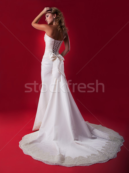 Blond hair girl fiancee in long wedding dress studio shot Stock photo © gromovataya