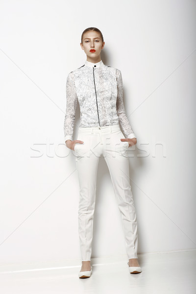 High Fashion. Trendy Woman in White Breeches in Graceful Pose. Spring Time Collection Stock photo © gromovataya