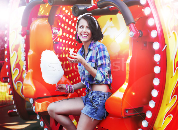 Lifestyle. Young Happy Woman Eating Sweetened Cotton Candy in Funfair Stock photo © gromovataya