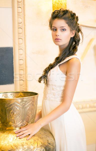 Luxurious Posh Brunette in White Dress. Oriental Antique Golden Decor Stock photo © gromovataya