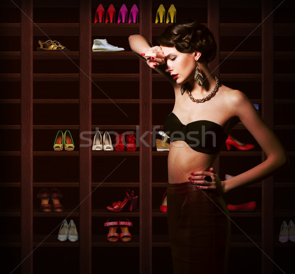 Confusion. Upset Woman Choosing what to Wear. Wardrobe with Footwear Stock photo © gromovataya