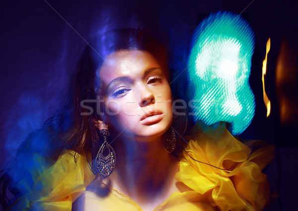 Motion. Stylized Woman in Radiant Abstract Lights. Illusion Stock photo © gromovataya