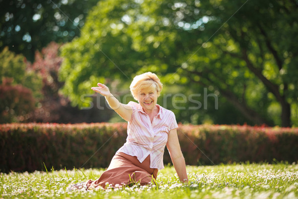 Enjoyment. Positive Emotions. Outgoing Old Woman Resting on Grass Stock photo © gromovataya