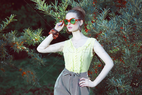 Stock photo: Charisma. Individuality. Luxurious Woman in Fancy Sunglasses Outside