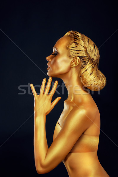 Woman with Golden Body over Black Background Stock photo © gromovataya