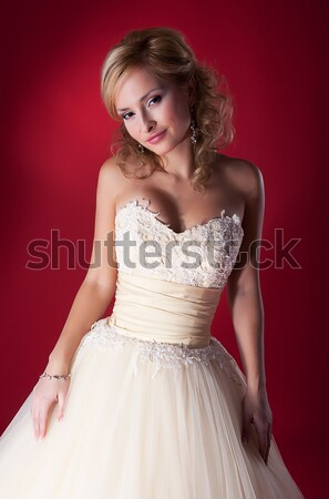 Bride in white nuptial short dress on red background Stock photo © gromovataya